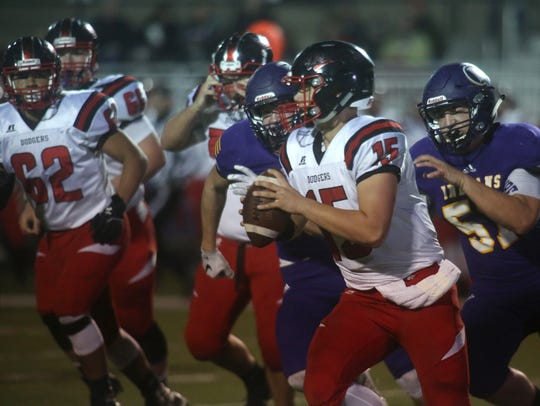 Fort Dodge junior quarterback Drake Miller is chased