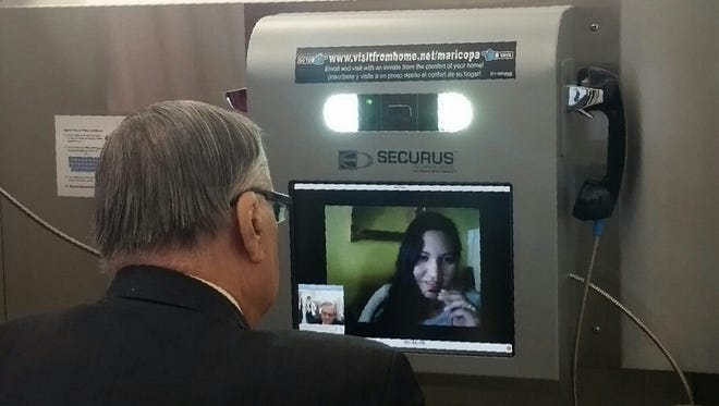 Sheriff Joe Arpaio chats with a women in Nogales, Sonora, Mexico, Thursday, Nov. 6, 2014, during a demonstration of the new video chat technology in Maricopa County jails.