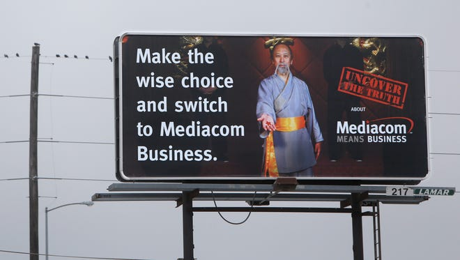 This Mediacom billboard is on the east side of North Glenstone Avenue  just north of St. Louis Street.