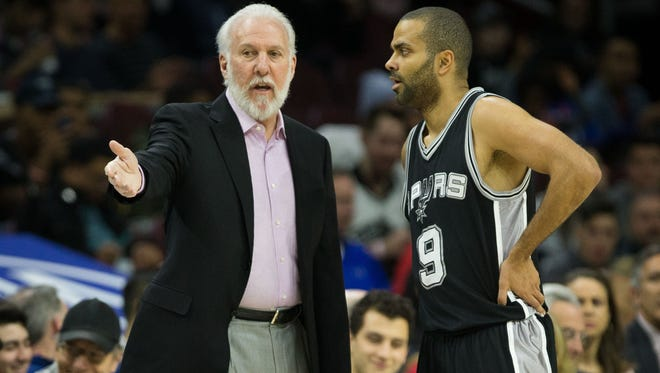 Feb 8, 2017; Philadelphia, PA, USA; San Antonio Spurs head coach Gregg Popovich talks with guard Tony Parker (9) during a break in action against the Philadelphia 76ers in the first quarter at Wells Fargo Center. Mandatory Credit: Bill Streicher-USA TODAY Sports