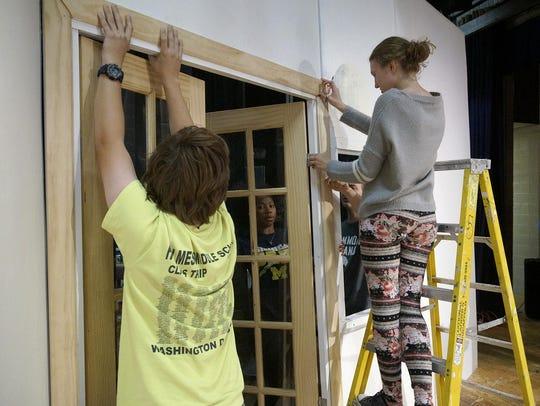 Crew members Trevor Bonifield, Allison Kaupp, (inside