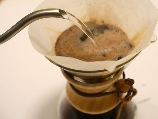 Hot water is added to the Chemex brewer.