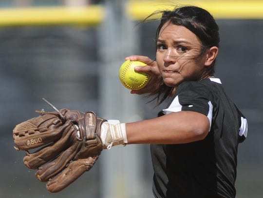 Abilene High shortstop Alyssa Washington throws to