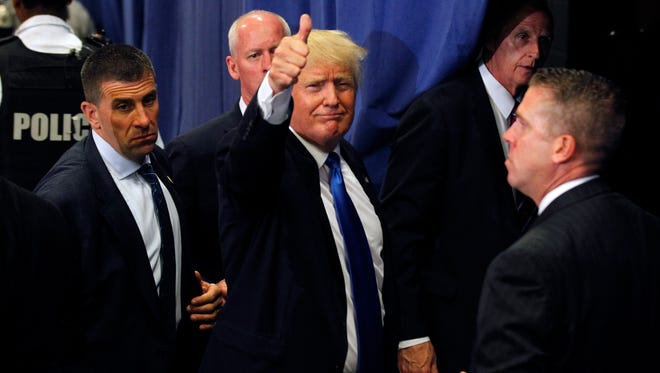 Donald Trump waves to the crowd after a campaign rally at the Sharonville Convention Center in Cincinnati on July 6, 2016.