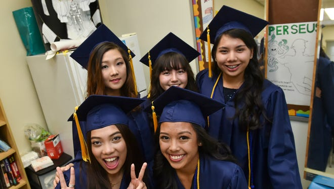 St. John's School Class of 2017 graduating students get together for pictures before their commencement ceremony in Tumon on May 27, 2017.