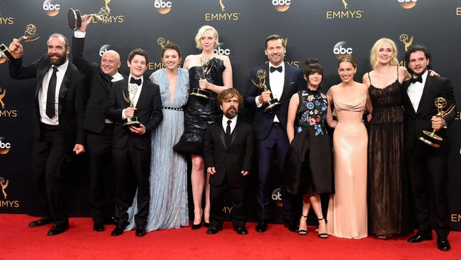 """Actors Rory McCann, from left, Conleth Hill, Iwan Rheon, Gwendoline Christie, Peter Dinklage, Nikolaj Coster-Waldau, Maisie Williams, Emilia Clarke, Sophie Turner and Kit Harington, winners of Best Drama Series for """"Game of Thrones,"""" pose in the press room Sunday during the 68th annual Primetime Emmy Awards."""