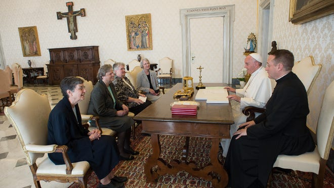 Pope Francis, second right, talks with a delegation of The Leadership Conference of Women Religious during an audience in the pontiff's studio at the Vatican on April 16, 2015.
