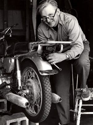 Author Robert M. Pirsig working on a motorcycle in 1975.