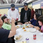 Pastor Dale Draper and his wife Starla meet with Charles Pierce, from left, Paula Harris, Kimberly Thompson and Kim Harris during Thanksgiving dinner Tuesday, November 24, 2015, at the Center @ Jenks Rest in Columbian Park. The Drapers, from Greater Macedonia Church, organized the dinner. The Drapers are committed to sheltering and caring for the homeless and less fortunate in this community.