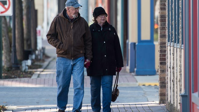 Fred and Cindy Wilson walk down East Main Street in downtown Richmond on Small Business Saturday, Nov. 25, 2017.