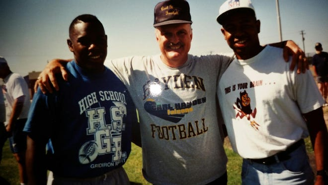 Vanderbilt coach Derek Mason, from left, Carl Hayden High coach Gary Somo and former NFL player Kevin Miniefield, Mason's high school teammate, in 1993.