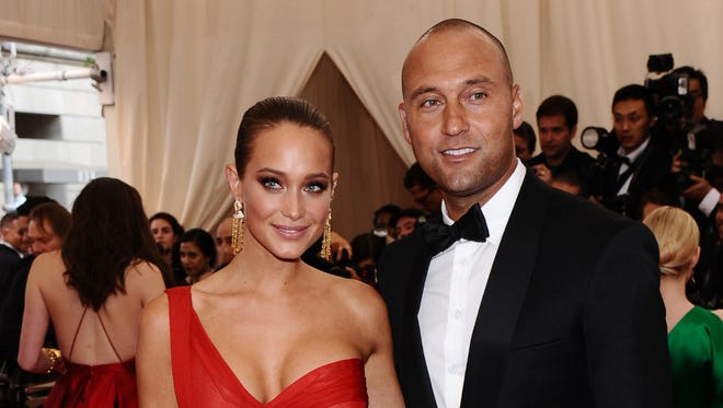 "FILE - In this May 4, 2015, file photo, Derek Jeter, right, and Hannah Davis arrive at The Metropolitan Museum of Art's Costume Institute benefit gala celebrating ""China: Through the Looking Glass"" in New York. Jeter has introduced his dog Kane to the world in a post Tuesday, Nov. 3, on his website, The Players' Tribune ó he also slipped into the essay he's engaged to Davis. (Photo by Charles Sykes/Invision/AP, File) ORG XMIT: NY119"
