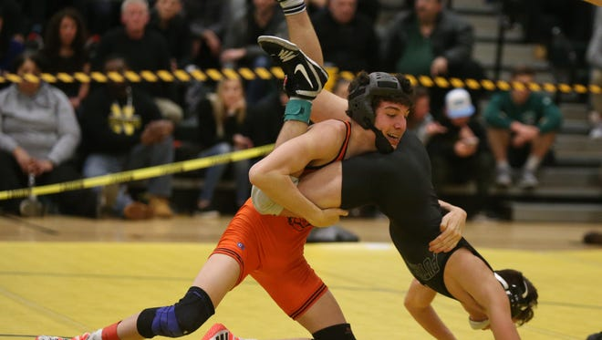 Pawling's Alex Santana defeats Putnam Valley/Haldane's Hunter Lundberg in the 113-pound match at the Section 1, Division 2 Wrestling finals at Hasting High School in Hastings on Hudson on Saturday, February 10, 2018.