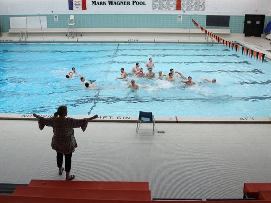 Susan VandeVenter, coach for the Valley High School Tigerlillies synchronized swim team, works with the boys who will perform in the team's water show, during practice Tuesday, March 29, 2016, at the Valley High School pool. The team of swimmers is preparing for its show on the second weekend in April.