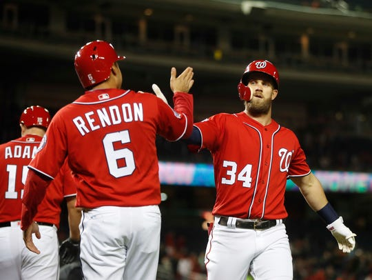 Washington Nationals Bryce Harper (34) is greeted by