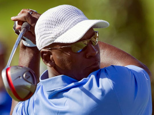 Former basketball player Michael Jordan tees off on