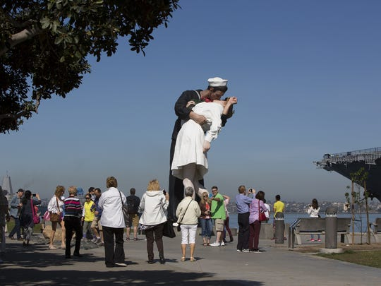 Tourists snap photos of the Unconditional Surrender statue at the Embarcadero in San Diego, on Wed. April 5th, 2017.