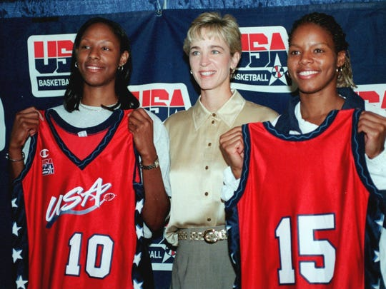 In this 1999 file photo, Nikki McCray, right, stands with Nell Fortner, center, and Chamique Holdsclaw at the MCI Center in Washington on Aug. 14, 1999.