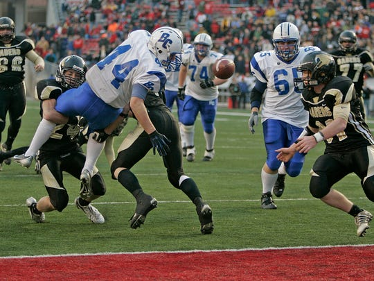 Brookfield Centrals' Drew Herma is hit and fumbles into the endzone and Franklin recovers in overtime to clinch the 2006 state championship.