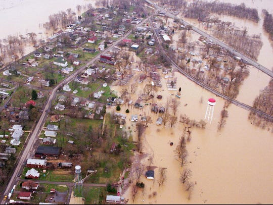 The small town of West Point, Ky., sits like an island between the Ohio River, left, and the Salt River, right. March 4, 1997