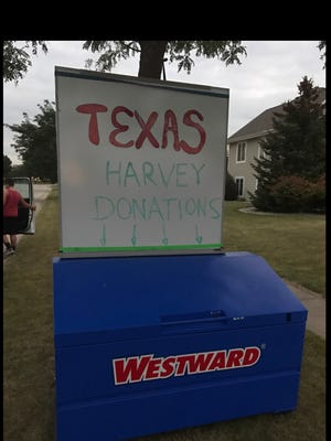 A collection box in a Mukwonago neighborhood welcomed contributions to help flood victims of Hurricane Harvey.