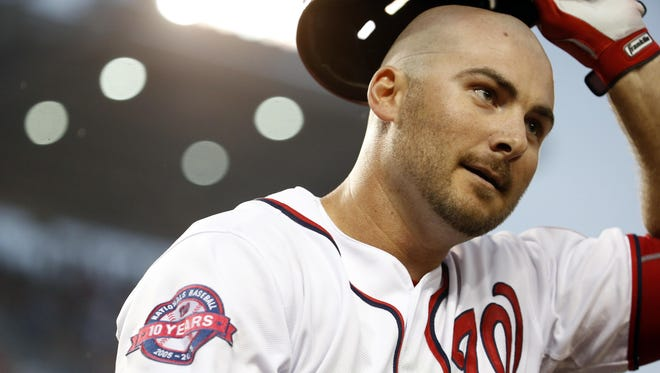 Clint Robinson smiles after hitting a two-run homer for the Nationals on July 3.