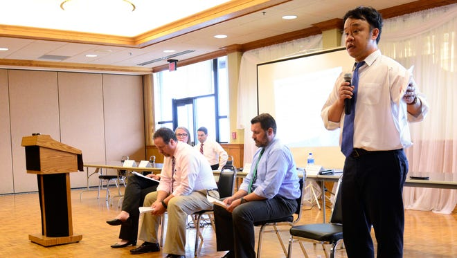 Bill Lin, of the U.S. Nuclear Regulatory Commission, tells the audience at a Port Clinton meeting Tuesday night that if the Davis-Besse nuclear plant shuts down in May 2020, hisagency would have two resident inspectors monitor safety during a 6-to-12 month transition period.