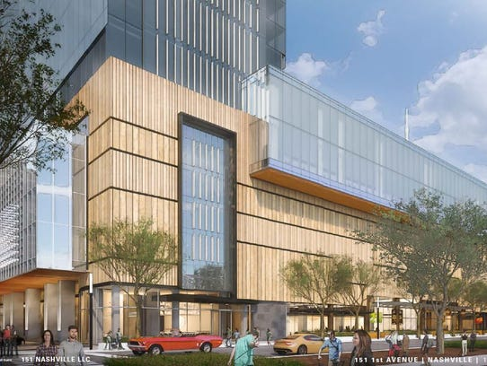 A rendering shows a planned high-rise northwest along
