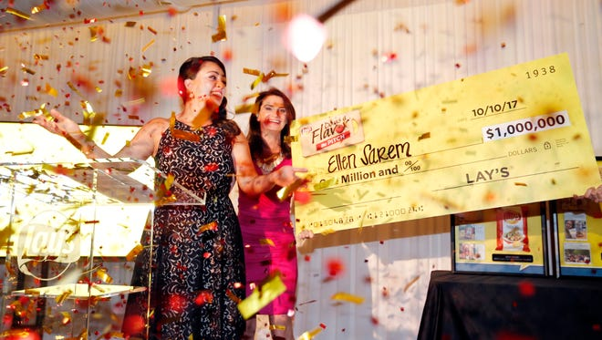 """Jennifer Saenz, Frito-Lay North America chief marketing officer, awards Ellen Sarem (left), of San Antonio, Texas, the $1 million grand prize in this year's Lay's """"Do Us a Flavor"""" contest Oct. 10, 2017, in Dallas. Sarem's winning flavor, Crispy Taco, was inspired by her fiancé's favorite dish."""