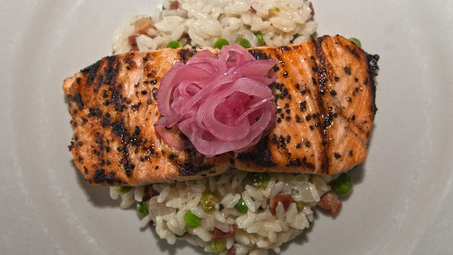 Grilled salmon with risotto and pickled onionsis prepared by Dave Levecchia at Trattoria Figaro in Mount Laurel.