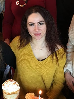 Nada Huranieh is pictured here celebrating her birthday with friends. The Farmington Hills woman is being remembered as a gentle soul.