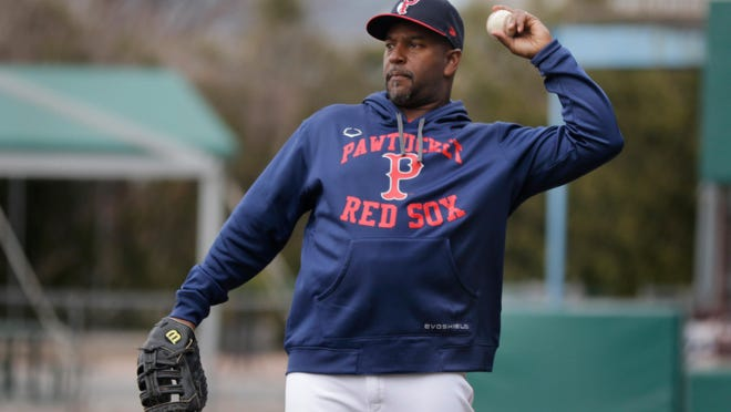 PawSox manager Billy McMillon helps out during batting practice last season. He is in charge of coaching Boston's top prospects who have been assigned to McCoy Stadium, the Red Sox' alternate Summer Camp site.