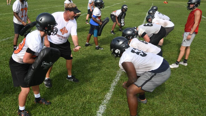 New Hanover offensive linemen run drills with new head coach Dylan Dimock guiding the way during preseason practice in 2019.