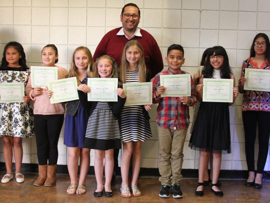 "Student winners in the writing category at the Cesar Chavez ""Celebrating our Latino Heroes"" awards."