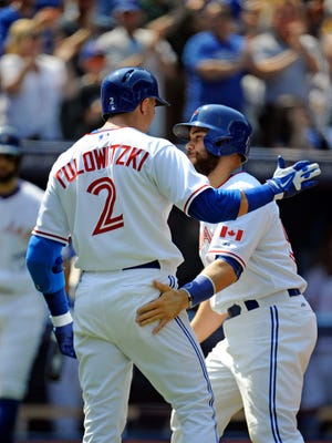 Aug 30, 2015; Toronto, Ontario, CAN; Toronto Blue Jays catcher Russell Martin (55) is congratulated by short stop Troy Tulowitzki (2) after he hit a two run home run against Detroit Tigers in the fourth inning at Rogers Centre.