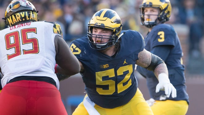 Mason Cole started 51 consecutive games at Michigan, which is a program record for an offensive lineman.