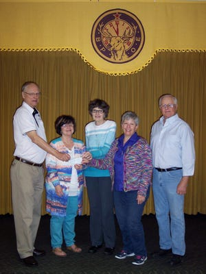The Mountain Home Elks Lodge 1714 recently donated $1,000 to the local Backpack Food 4 Kids program. Shown are Don Swanson, from left, Elks president; Linda DeMass, Kathy Bauer, Jo Strickland, co-directors of the Backpack program; and Butch Holligan, Elks grant coordinator.