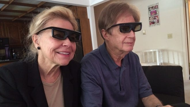 "Sandra House and Cliff House review footage from their 3D Christian film, ""Heaven Won't Wait, at their Springfield home Monday. Their movie will compete in the International Family Film Festival in Hollywood, Calif. Nov. 6."