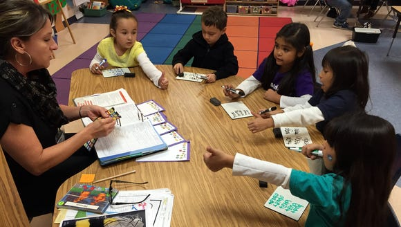 Students in a trilingual kindergarten class practice