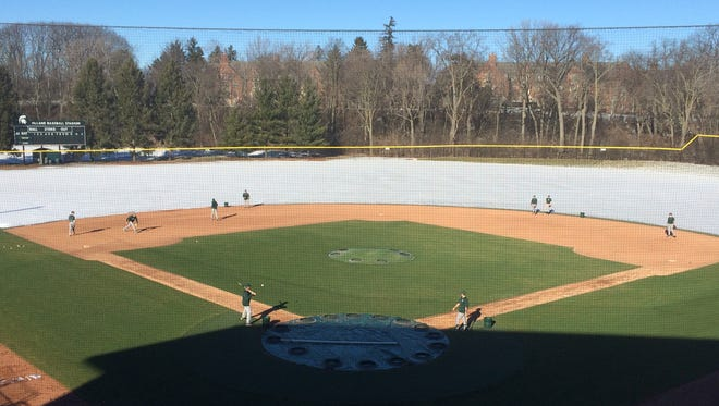 MSU's baseball team takes ground balls Jan. 29 on McLane Stadium's heated infield.