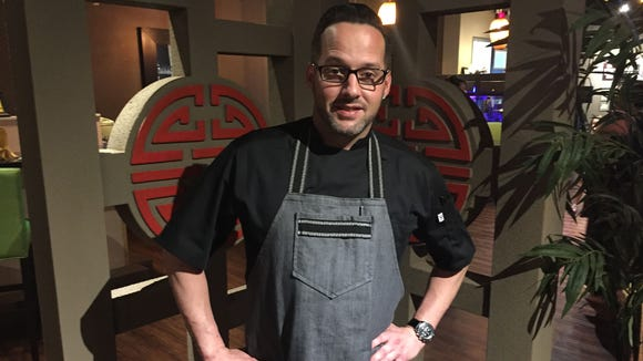 """Chef Garrett Welch, who won """"Guy's Grocery Games"""" last fall, is teaching cooking classes at Red Ginger in Melbourne."""