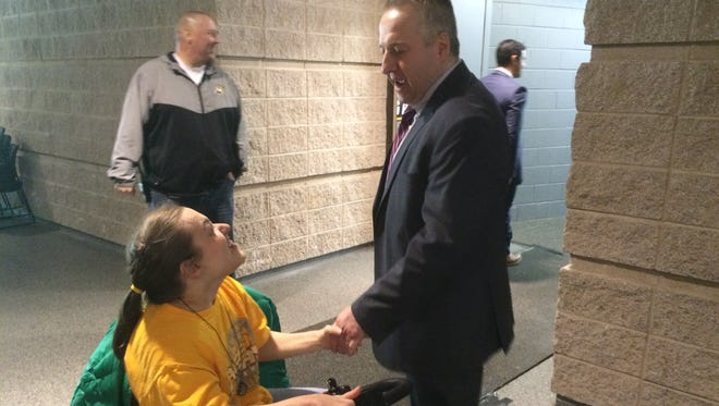 Micaela Diedrick greets Green Bay Gamblers coach Pat Mikesch following the team's 4-1 victory over Dubuque on April 3 at the Resch Center.