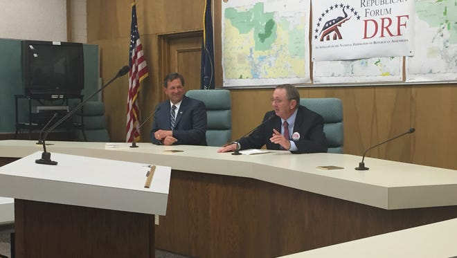 From left, Gil Almquist and Dean Cox, candidates vying for Washington County Commissioner, answer questions from the public at a forum. Almquist said the Dixie spirit will solve the problem many think Lake Powell Pipeline will solve, while Cox said neighboring states will take the water if Utah doesn't use it.