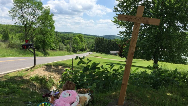 A memorial for crash victim Samyra Oakley, 4, remained at the scene Tuesday on East Main Road in the Town of Union.