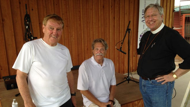 Jimmy Exum, Jerry Gay and Tommy Rhoads pause while preparing the AMP for this evenings concert.