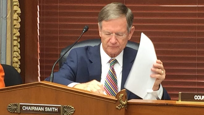 Republican Rep. Lamar Smith of Texas looks through papers during a hearing before the House Science, Space and Technology Committee on Wednesday, Sept. 14, 2016