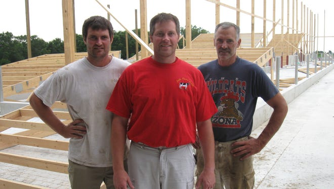 The Loehr brothers (from left) Mark, Joe and Dan, together own Loehr Dairy near the Holyland.
