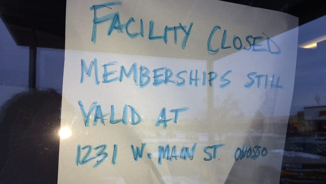 Sign greeting members of Fitness US, directing them to another facility 34 miles away.