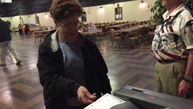 Carol Walters casts her ballot at American Legion, a precinct in Ballville Township. A levy to expand the Sandusky County Drug Task Force passed by a narrow margin Tuesday.