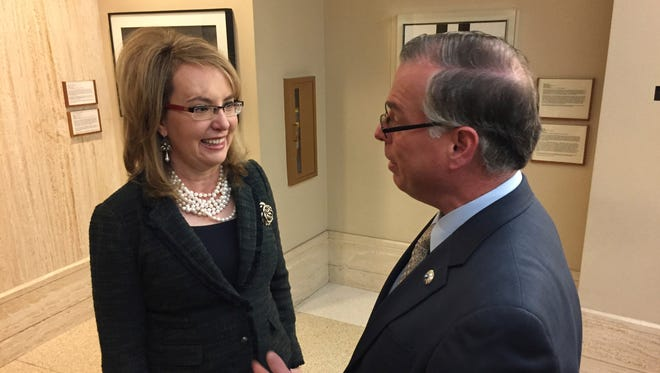 In this Feb. 22, 2017, file photo, former U.S. Congresswoman and shooting survivor Gabrielle Giffords, left, talks with Democratic New Mexico Sen. Daniel Ivey-Soto in Santa Fe, N.M. A national gun-safety group on Tuesday, Aug. 1, 2017, stepped up pressure in New Mexico against proposed U.S. firearms legislation that would make states recognize concealed handgun permits from other states.